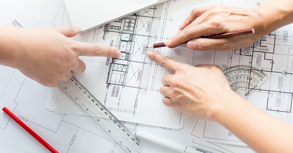 hands pointing at a design drawing