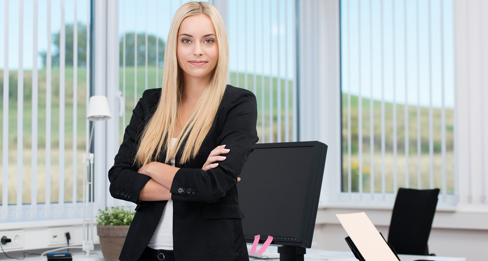 Smiling girl standing in an office