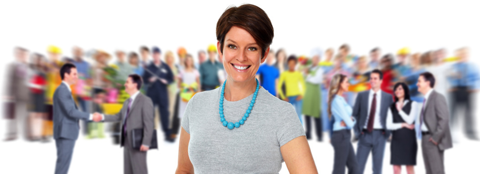 smiling woman in front of a crowd of people